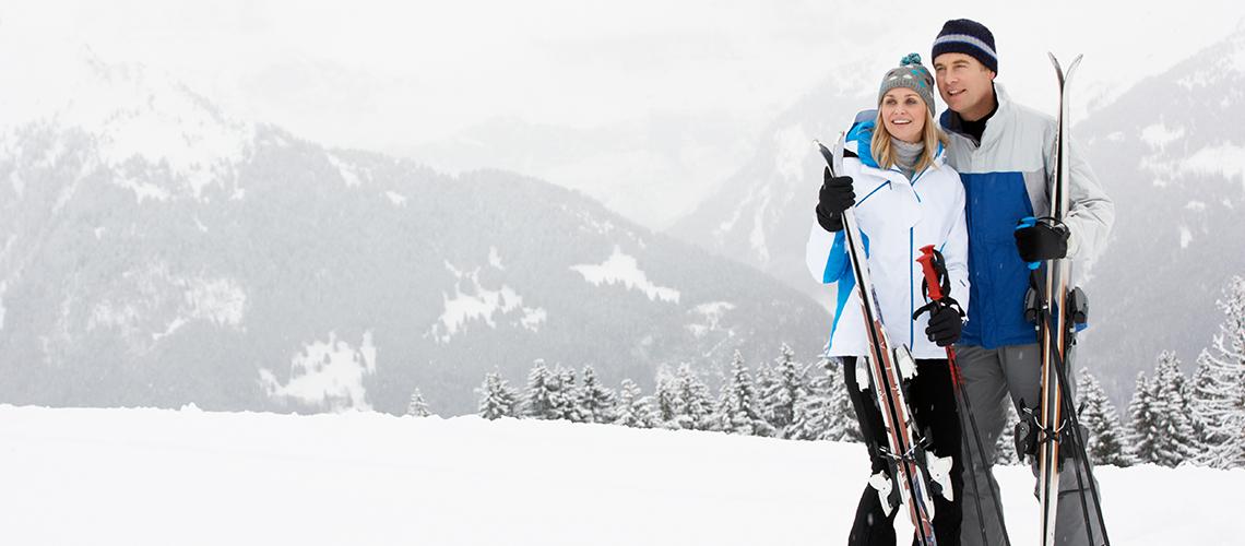 knob-hill-inn-sun-valley-couple-skiing